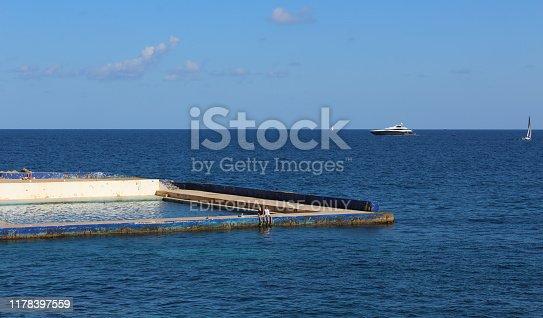 Sliema, Malta - 6th November 2018: People swimming and relaxing at Sliema Pitch swimming pool in Sliema