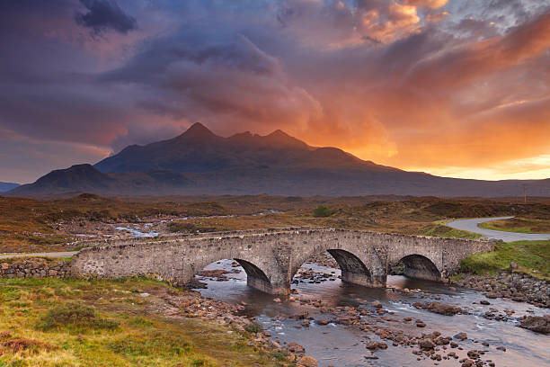 Sligachan Bridge and The Cuillins, Isle of Skye at sunset The Sligachan Bridge with The Cuillins in the background on the Isle of Skye, Scotland. Beautiful clouds, photographed at sunset. isle of skye stock pictures, royalty-free photos & images