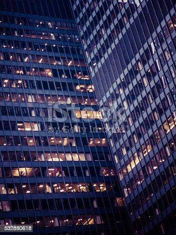 1154996700istockphoto Slightly defocused modern office building at night 532880618