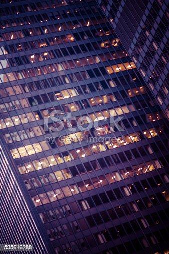 1154996700istockphoto Slightly defocused modern office building at night 535616288