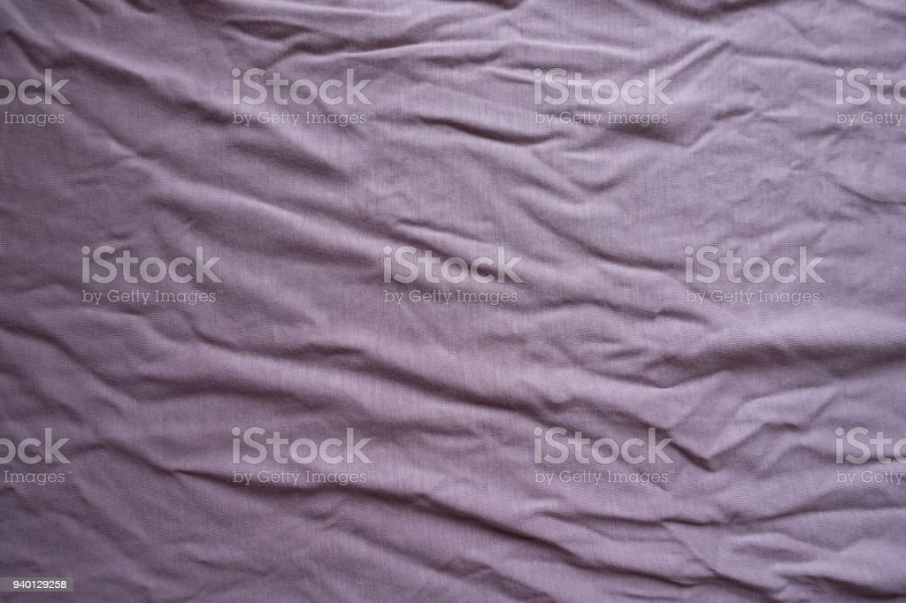 Slightly jammed pink viscose fabric from above stock photo