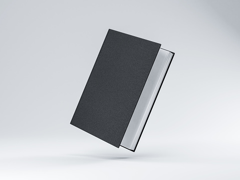istock Slightly opened Black Book Mockup with hard textured cover, white pages 1050245630