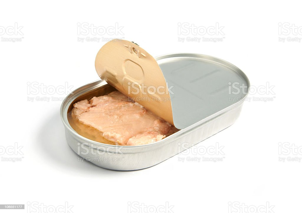 A slightly opened tin of pink salmon stock photo