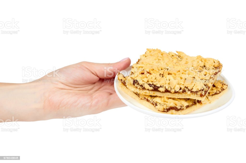 Slim apple pie with confiture in hand, isolated on white background stock photo