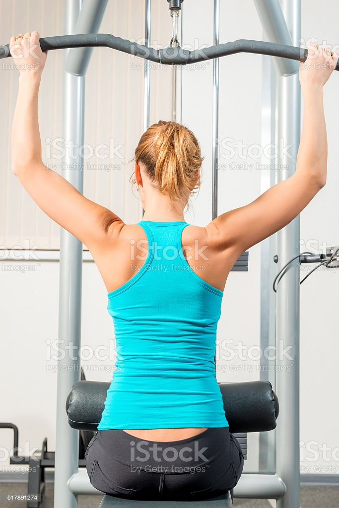 Slim athletic girl in the gym training stock photo