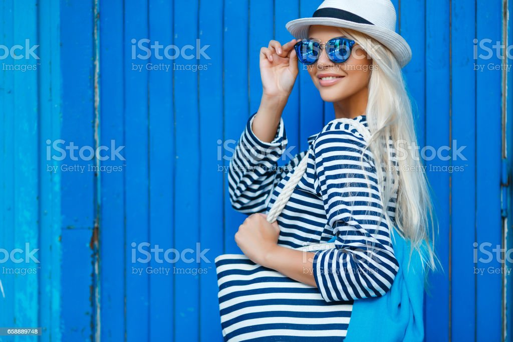 Slim blonde-year-old portrait of a beautiful woman in the marine vest stock photo