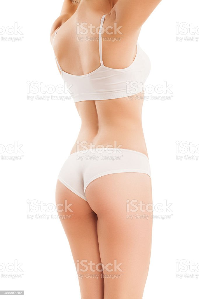 Slim body of woman isolated on white. stock photo