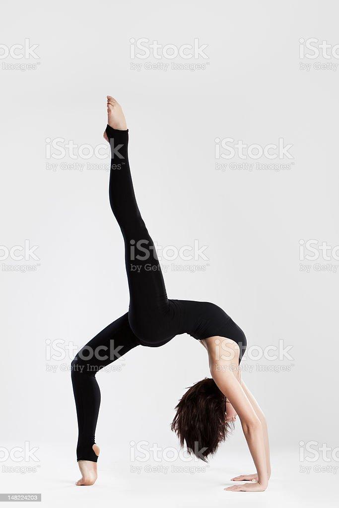 Slim dancer in yoga pose bending backwards royalty-free stock photo