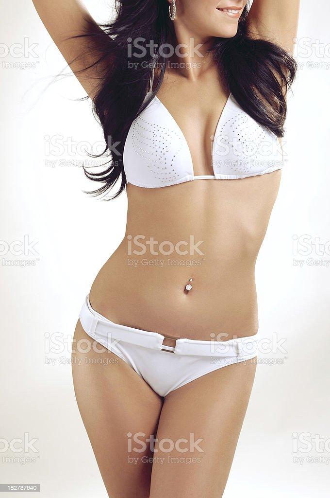 Slim female body with bikini royalty-free stock photo