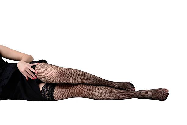 slim female legs in stockings stock photo