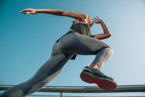 Slim fit sportswoman in motion while running stock photo stock photo