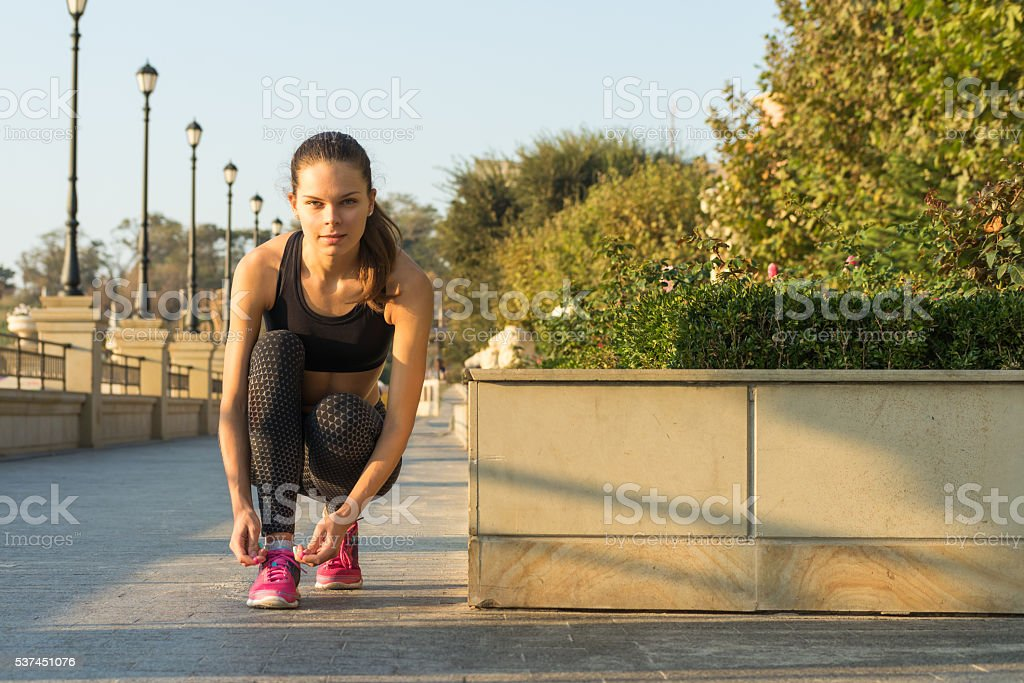 Slim girl in a sports pants and a bra stock photo