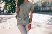 Slim girl in jeans and T-shirts