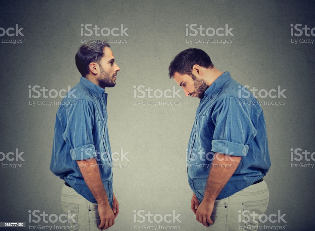 Slim guy looking at fat man himself. Diet choice right nutrition concept stock photo