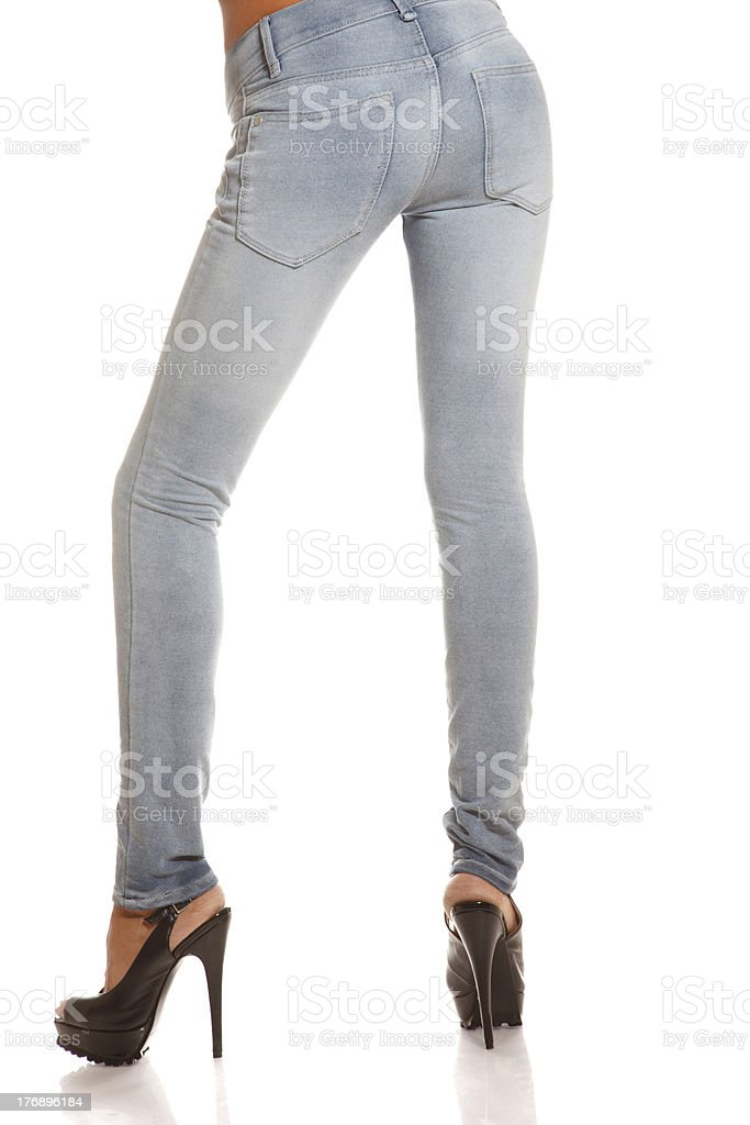 Slim legs in jeans stock photo