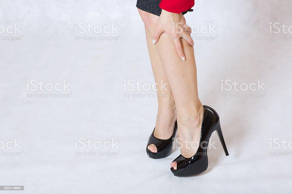 Slim legs on high heels stock photo