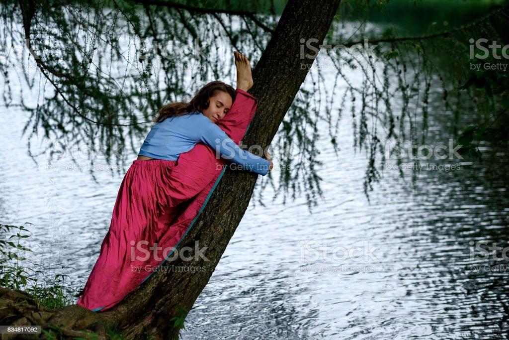 Slim sporty girl on white background sitting in splits, Monkey yoga pose, asana Hanumanasana, stretching practice stock photo