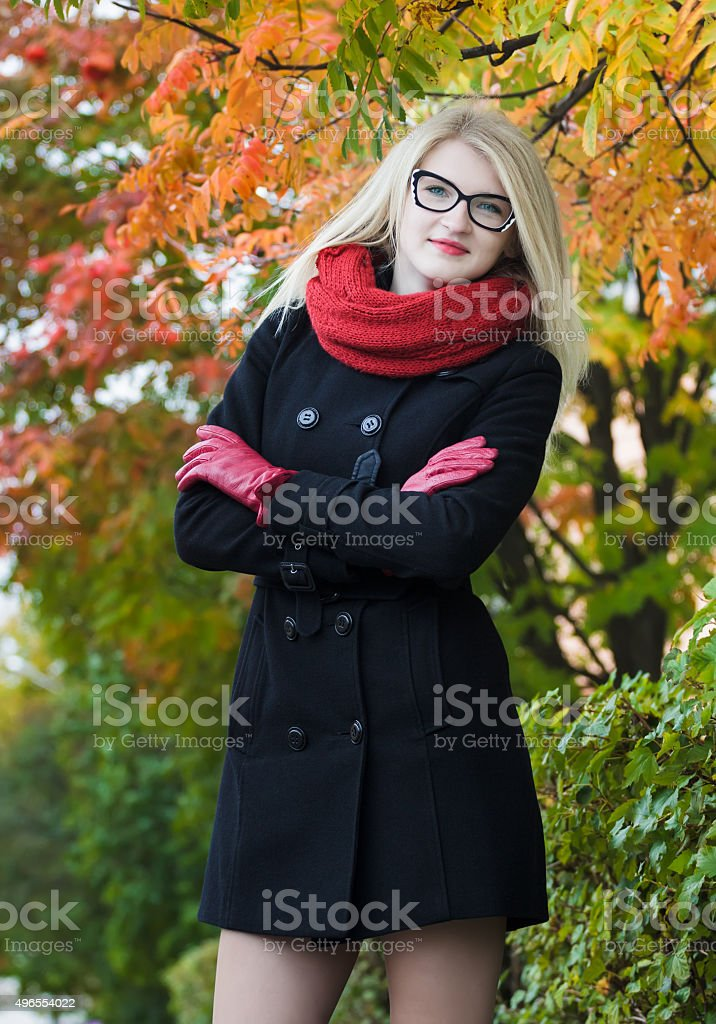 Slim student girl with crossed arms wearing cat eye glasses stock photo