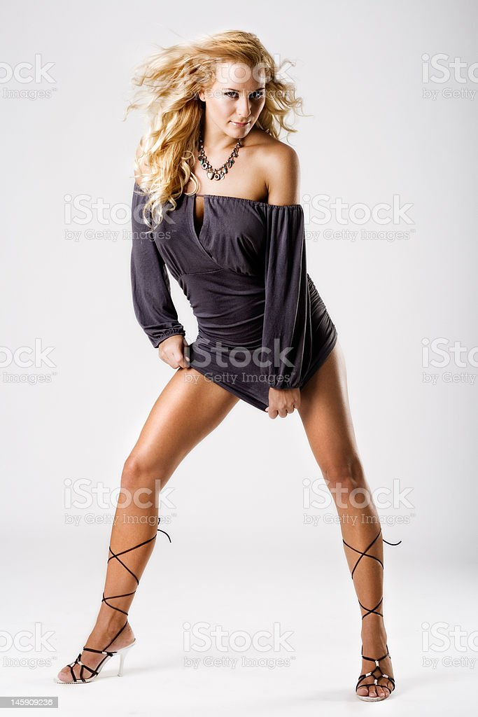 Slim tanned model with long legs in sexy dress royalty-free stock photo