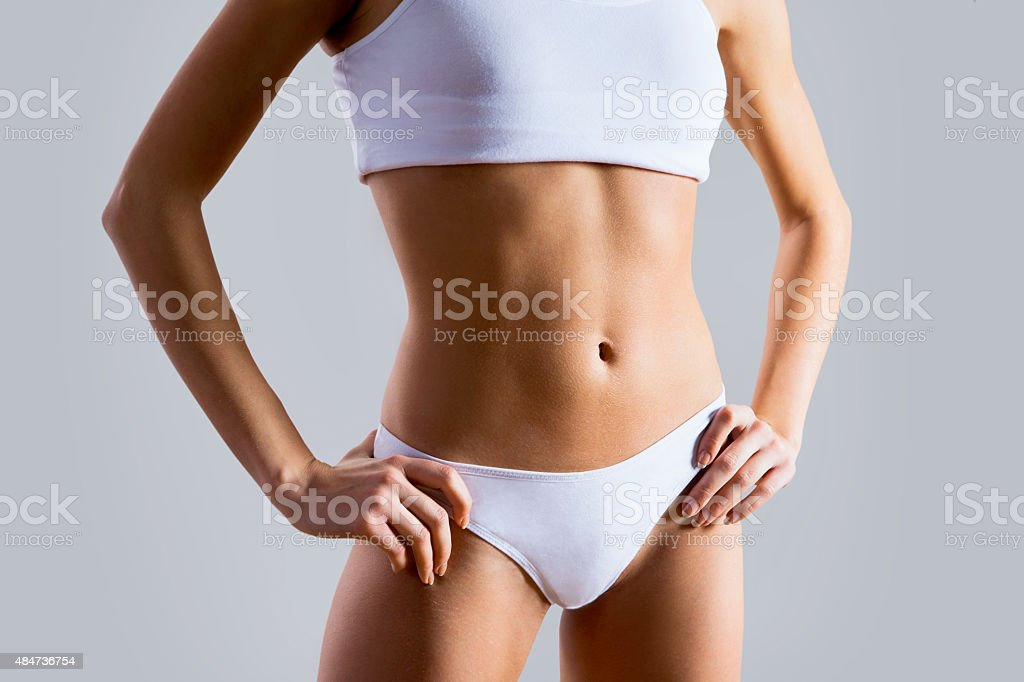 Slim tanned woman's body stock photo