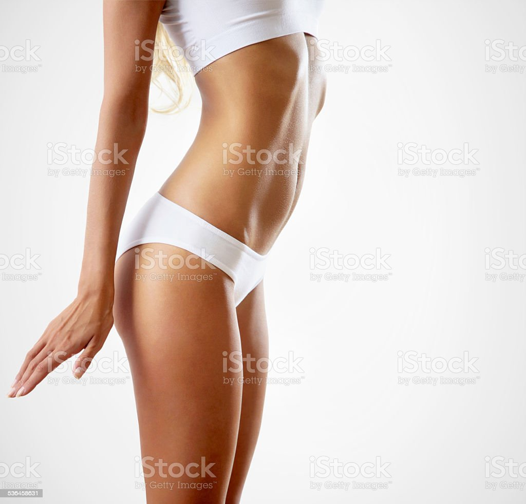 Slim tanned woman's body. stock photo