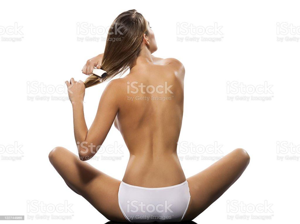 Slim woman combing hair royalty-free stock photo
