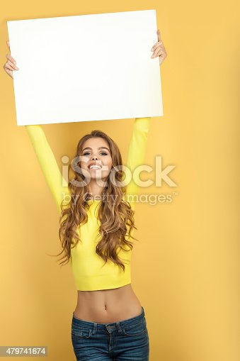 istock Slim woman holding white sheet of paper 479741674