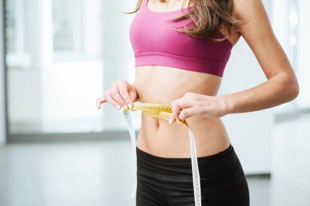 슬림 여자 측정 아주머니 여윔 허리 스톡 사진