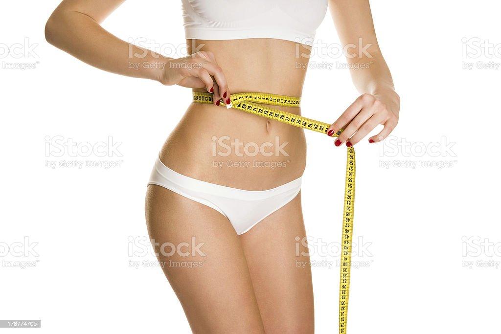 Slim woman measuring waist royalty-free stock photo