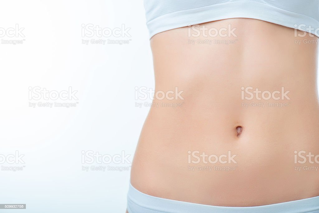 Slim woman standing isolated on white background stock photo