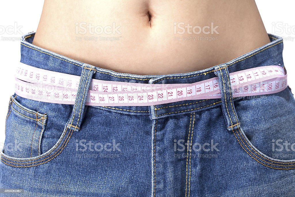 Slim Woman Wearing Loose Jeans stock photo