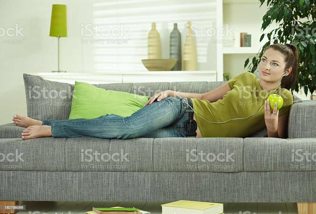 Slim young girl with green apple royalty-free stock photo