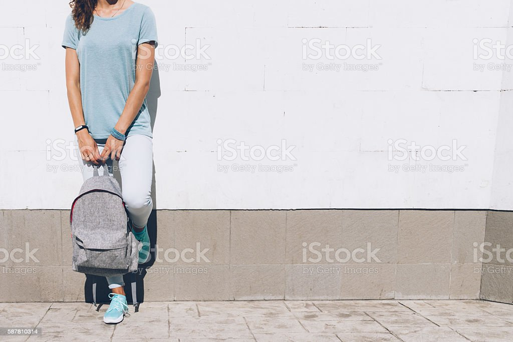 Slim young woman in jeans and t-shirt stock photo