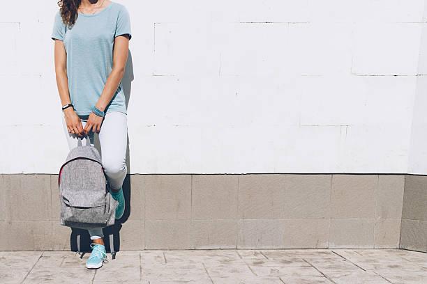 slim young woman in jeans and t-shirt - damenrucksack stock-fotos und bilder