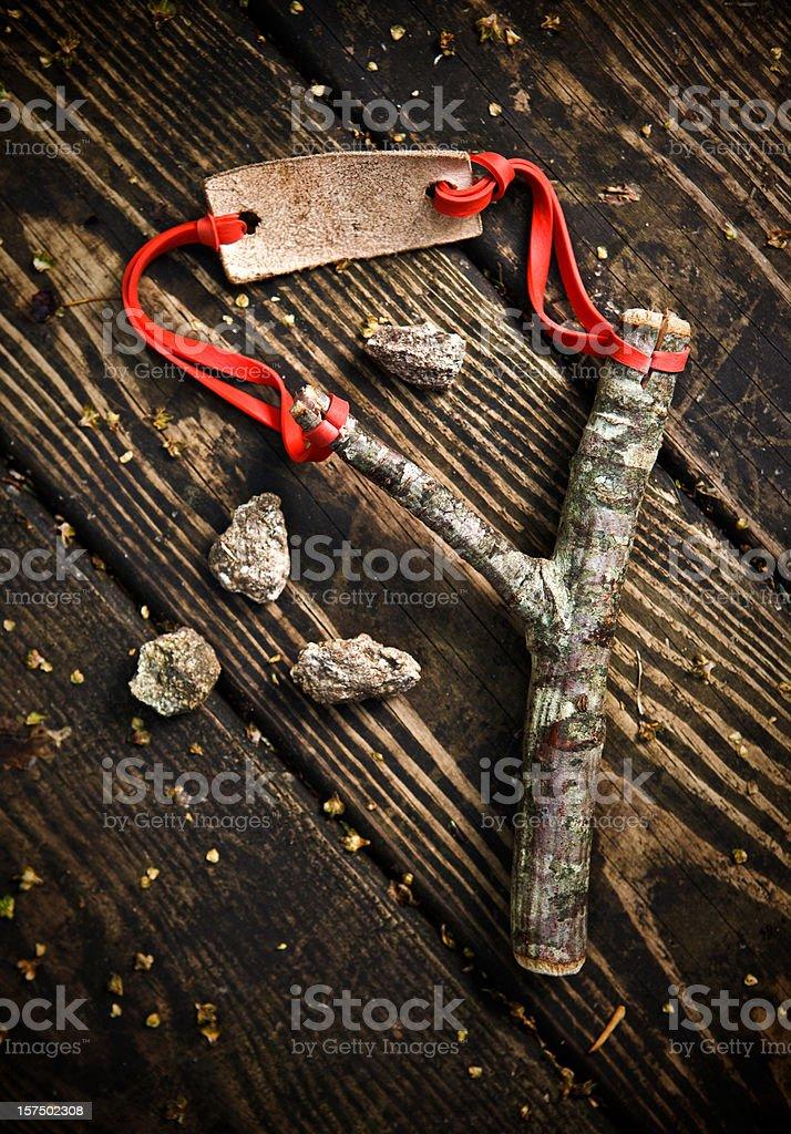 slingshot and stones stock photo