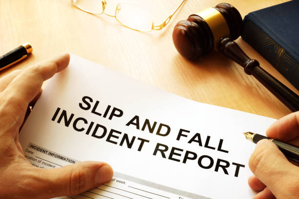 Slip and fall injury report on a table. Slip and fall injury report on a table. slippery stock pictures, royalty-free photos & images