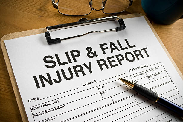 Slip and Fall Injury Report with clipboard on a desk stock photo