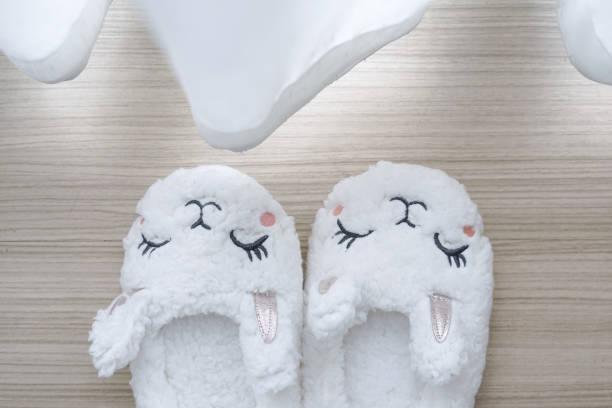slippers. a cute pair of white bunny slipper for little girl. soft and comfortable - unicorn bed imagens e fotografias de stock