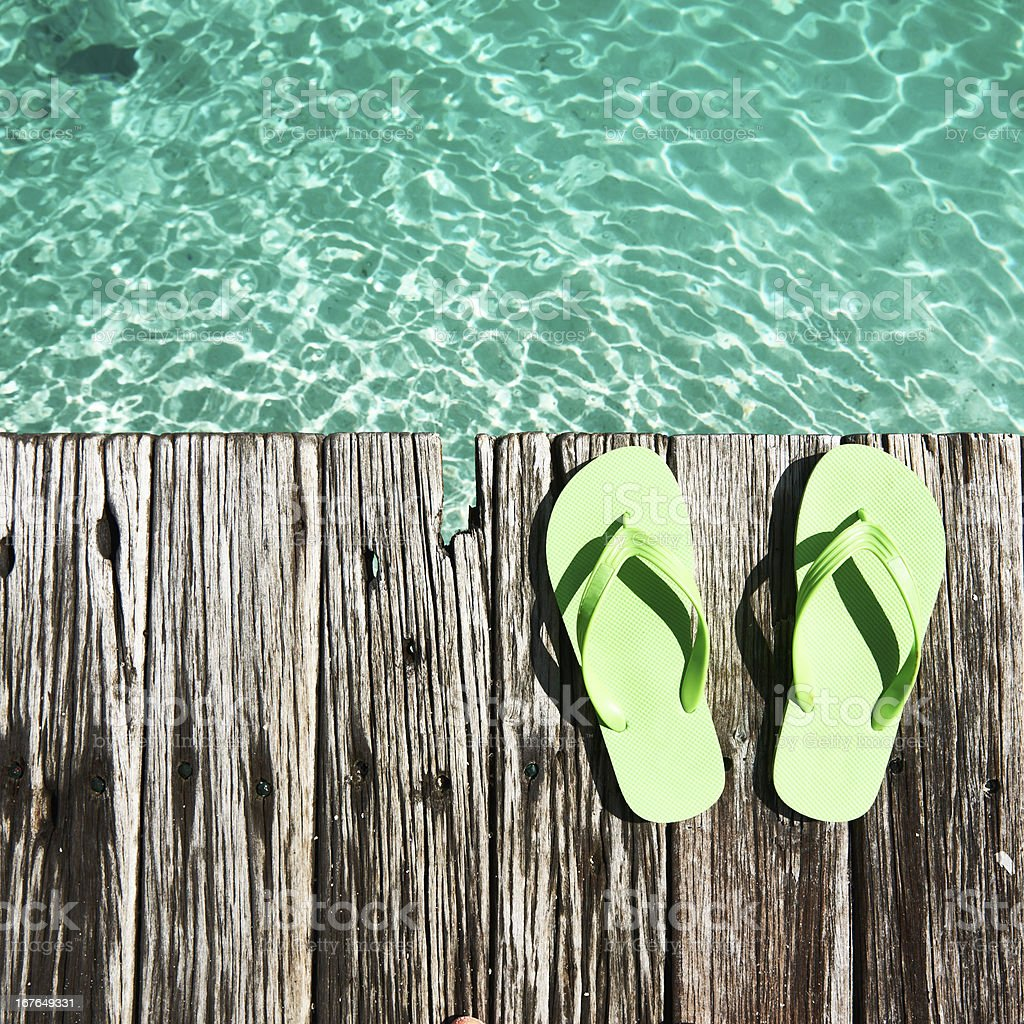 Slippers at jetty royalty-free stock photo