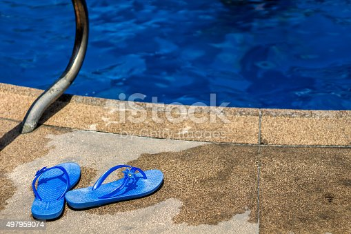 istock Slippers at pool 497959074