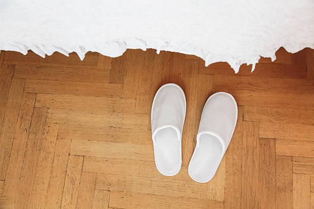 Slippers in bedroom stock photo