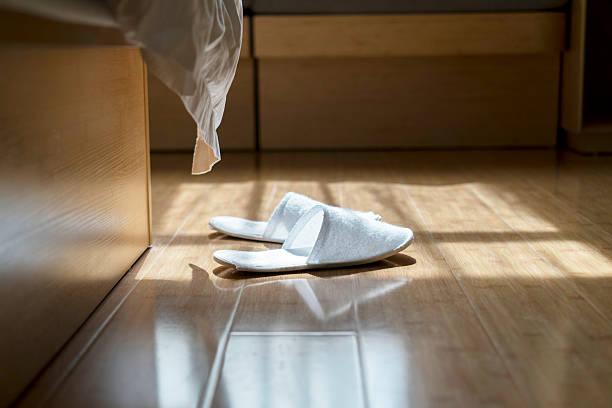 slippers on floor stock photo