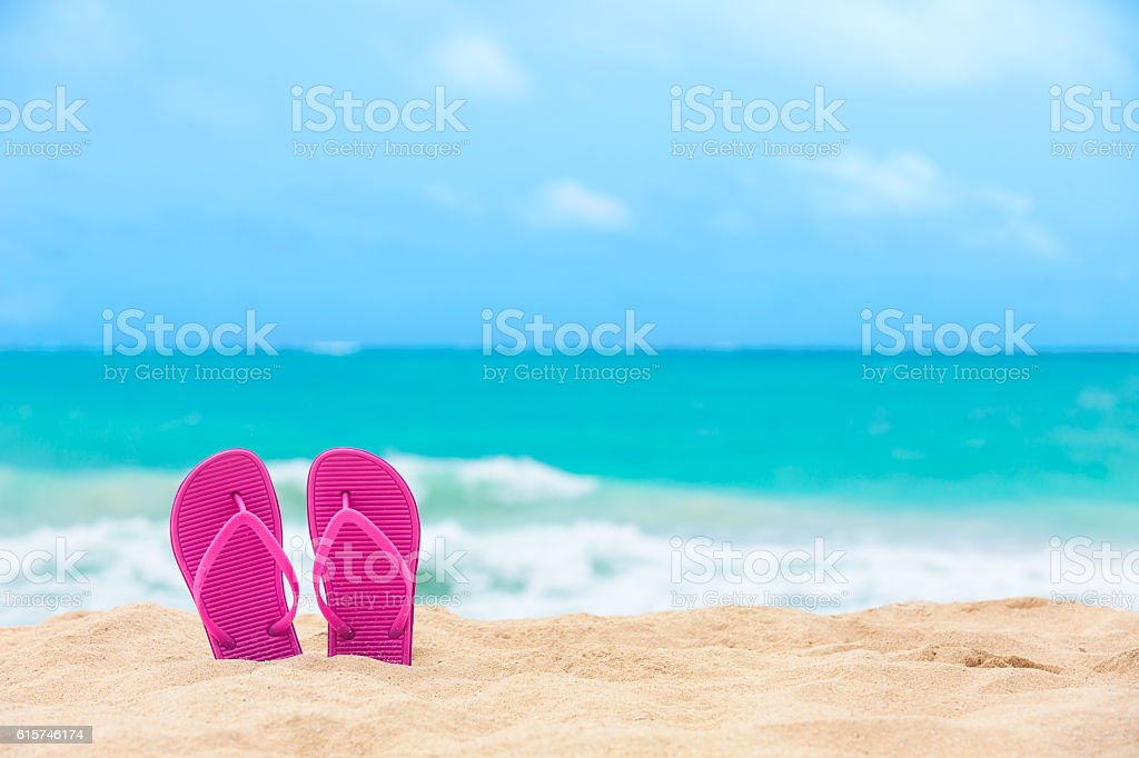 Slippers on the beach​​​ foto
