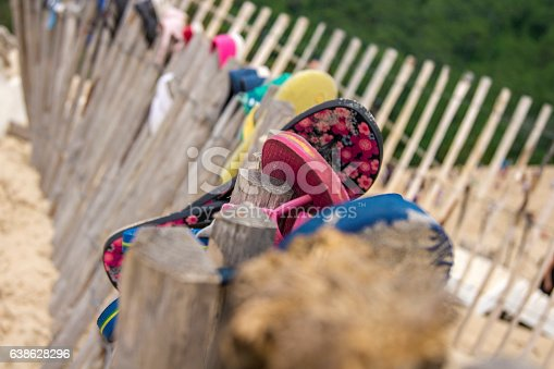 istock Slippers on the beach 638628296