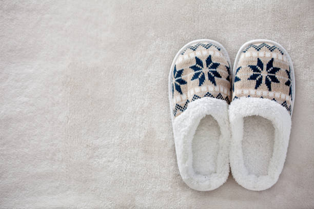 Slippers on the carpet stock photo