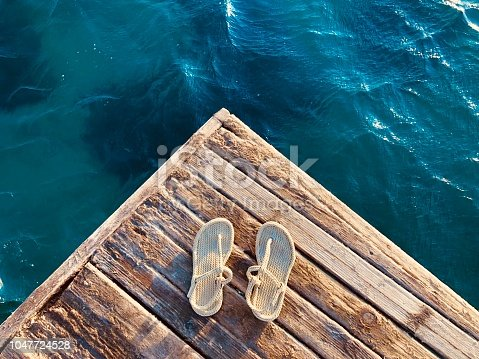 Slippers on the pier at sunset