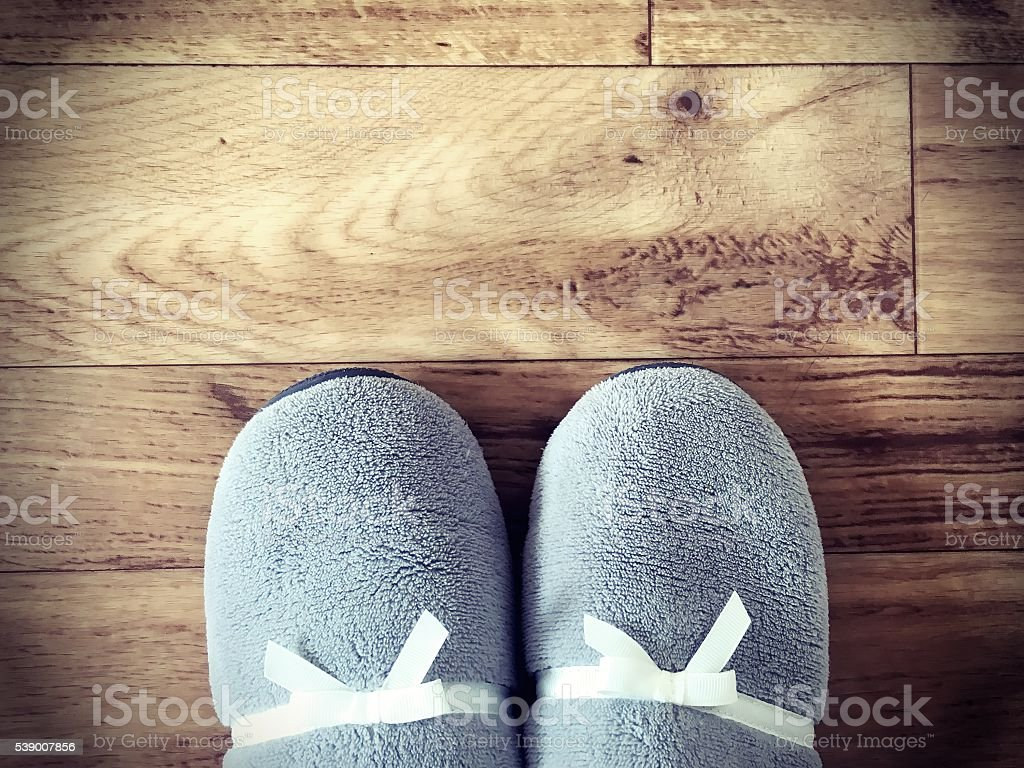 slippers on wooden floor top view with copy space stock photo