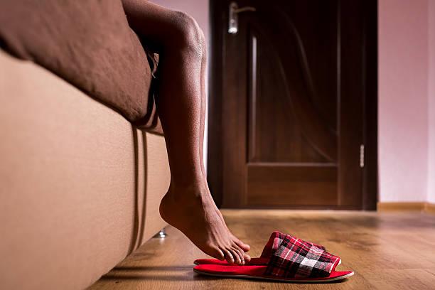 Slippers under afro kid's feet. stock photo