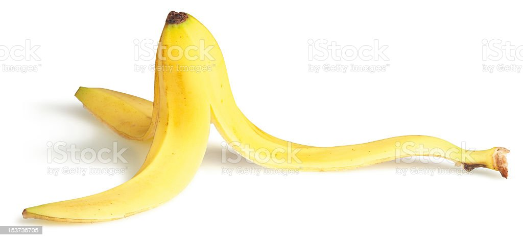 A slippery banana on a white background  stock photo