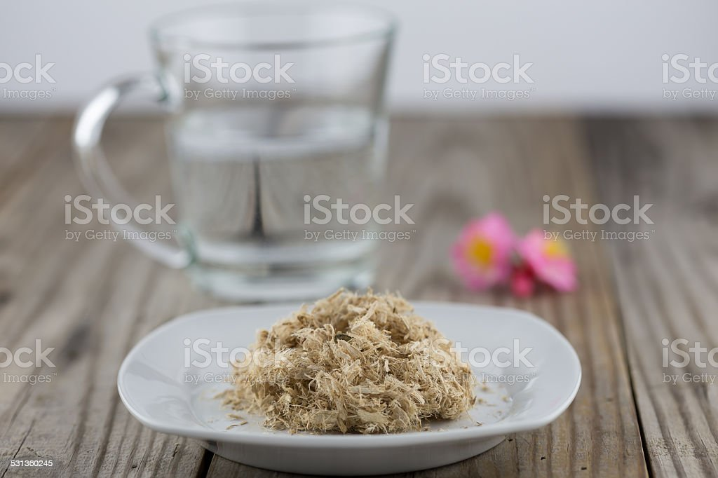 Slippery elm with a cup of water stock photo